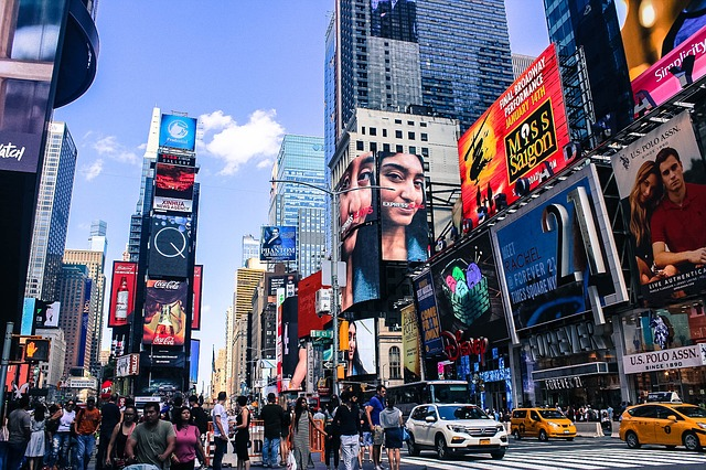 Traveling to New York: Stores, Theaters and Duratrans Ads Everywhere